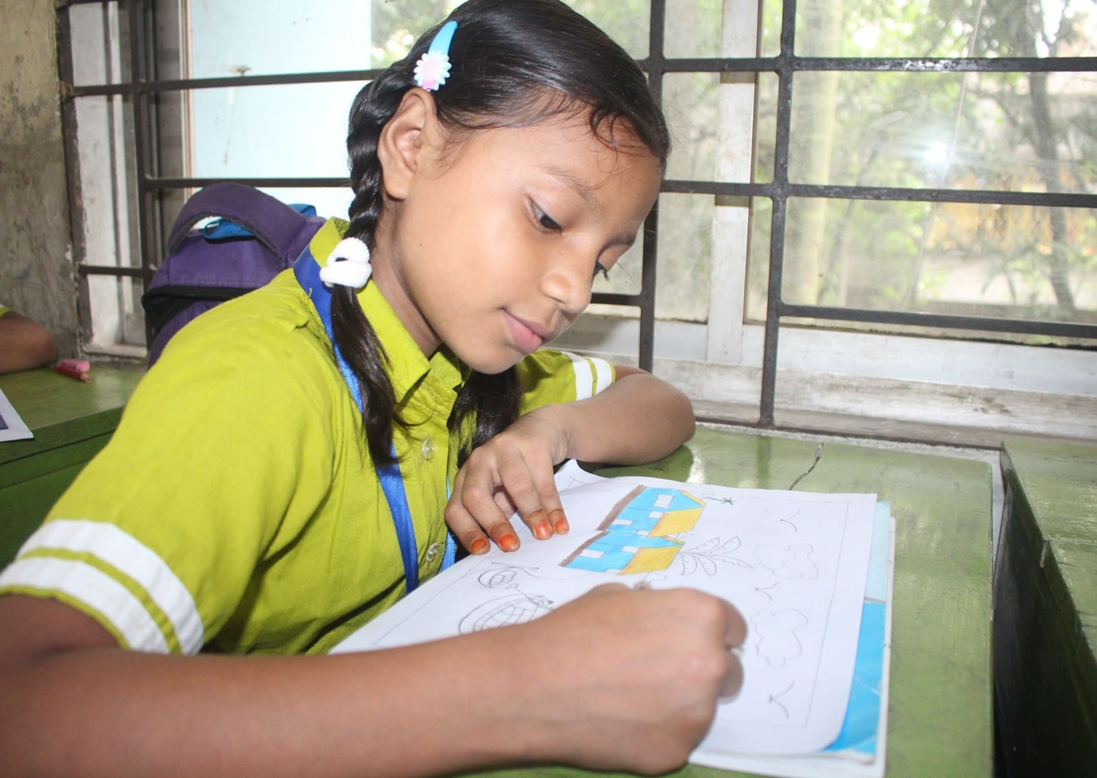 3. A girl drawing a pictures using color pencil and normal paer