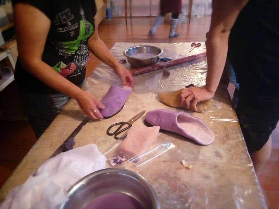 women making felt slippers in Kyrgyzstan