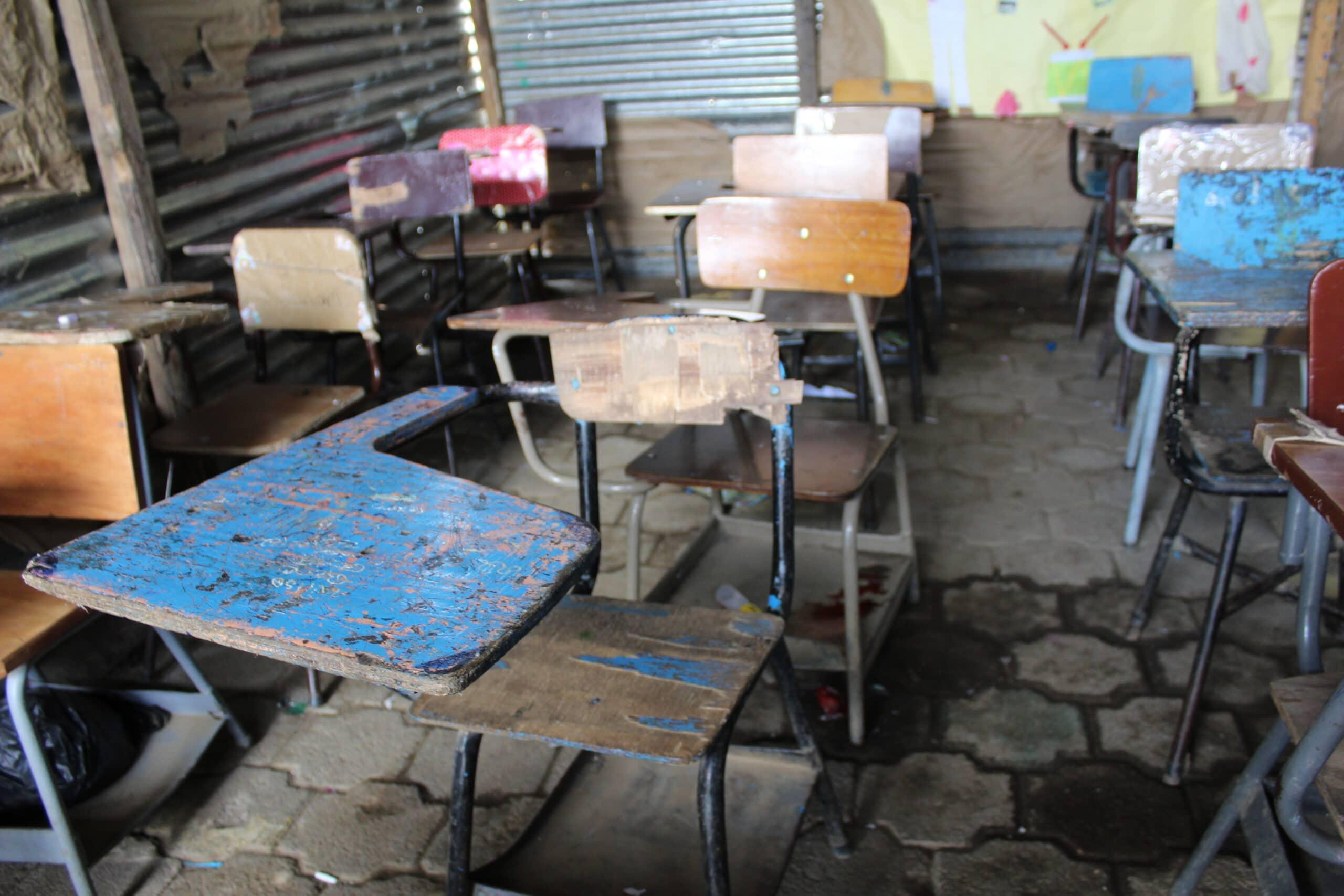 splintered desks and chairs at La Palangana