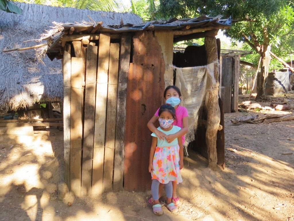 Before - Brihanny and Griselda visit the old community latrine