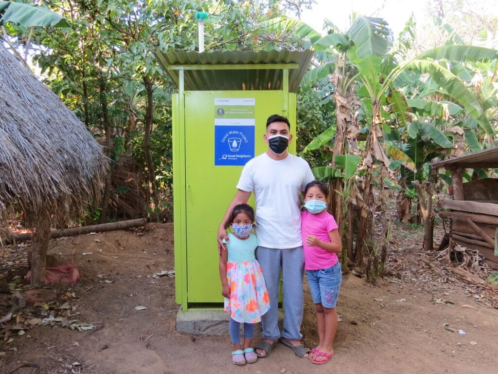 After - the girls with their dad in front of the new washroom