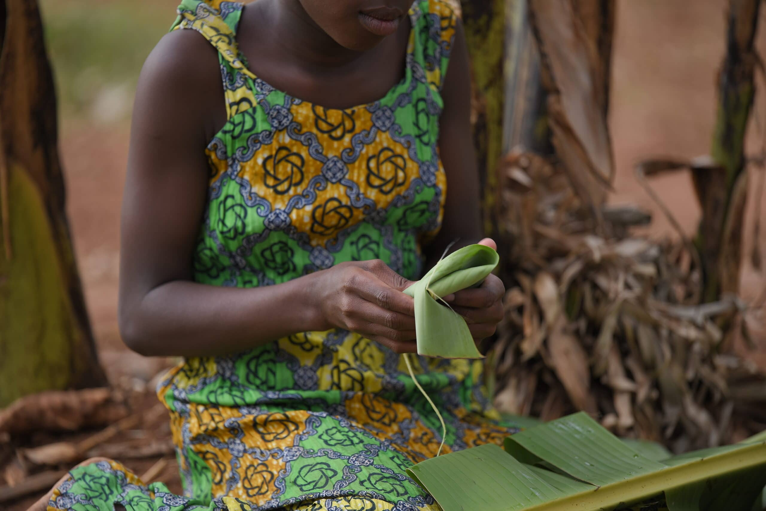 girl uses leaves instead of pads