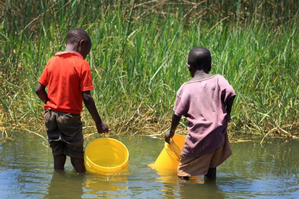 children get water from stream